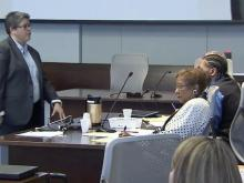 Durham County Assistant District Attorney Stormy Ellis looks at Laurence Lovette during closing arguments of his first-degree murder trial on July 28, 2014, as she tells jurors that he is guilty of robbing and fatally shooting Abhijit Mahato in January 2008.