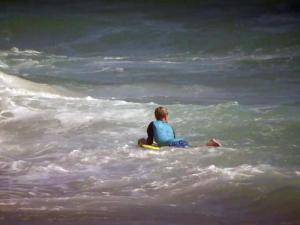 Rip current. boy in ocean, swimmer