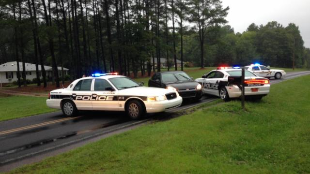 Law enforcement had cordoned off an area about one mile long on Patterson Road just north of N.C. Highway 98 (Wake Forest Highway) just after 6 p.m.