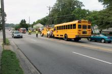 Three elementary school students were taken to Duke University Medical Center with minor injuries early Friday after a Durham school bus was hit by a pickup truck.