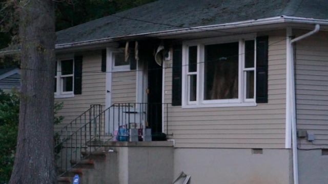 Eight people were displaced from a home at 210 N. Briggs Avenue in Durham Sunday afternoon after the residence caught on fire. (David McCorkle/WRAL)