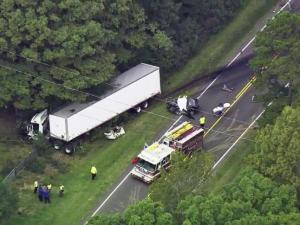 Tractor-trailer, car involved in wreck in Durham