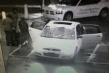 Police were seeking the public's help in identifying the car and persons in the surveillance images. The pictures depict a white 4-door car at the emergency room entrance of the hospital.