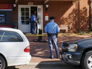 Police officers investigate a robbery at Wells Fargo bank at 2016 Fairview Road in Raleigh on Oct. 24, 2014.