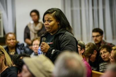 At a community meeting in Minneapolis, Lena Slaughter said she is afraid to go into her former neighborhood in the northern part of the city. It's the area of Minneapolis most plagued by violent crime. (Photo by James Robinson/Fayetteville Observer)
