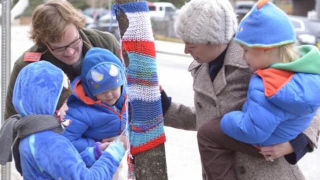 In 2013, a group of more than 70 neighbors adorned the trees in Glenwood South with hand-knit sweaters. Photo courtesy of Glenwood South Neighborhood Collaborative