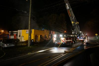 Tires and flammable liquids helped fuel an intense blaze Sunday night that destroyed a commercial building in Durham, authorities said.