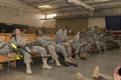 Soldiers wait to depart from Fort Bragg's Green Ramp Nov. 10, enroute to West Africa to participate in Operation United Assistance, the U.S. military mission supporting the international fight against the spread of the Ebola virus in West Africa.