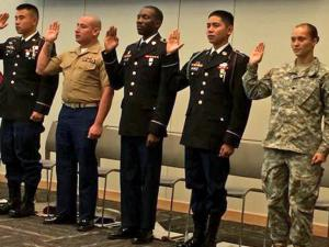 Six men and women who serve in the U.S. armed forces became citizens during a special naturalization ceremony Tuesday to mark Veterans Day.
