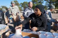 """In the """"Thanks for Giving"""" program, Operation Homefront provided 25 pounds of goods to 400 Fort Bragg soldiers and their families on Nov. 20, 2014. The families also received 10 pounds of items from Feed the Children and a frozen turkey."""