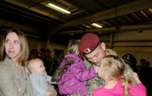 Chief Warrant Officer 2 Ryan Basso is reunited with his wife, Morgan, daughters Sarah and Aubrey, and his son, Zackary, during an emotional return from Afghanistan on Friday. Photo by Sgt. 1st Class Joseph Armas/82nd Airborne Division.