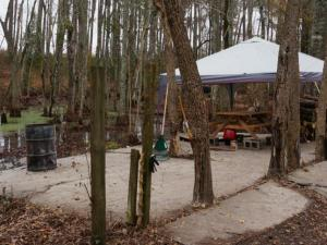 Robeson County authorities are investigating the deaths of three people found Nov. 30 in some woods  known as a party area  behind a home on McLeod Drive in Maxton.