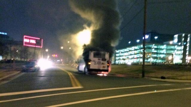 A Durham Area Transit Authority bus is a total loss, a city spokesman said, after the engine caught fire Tuesday night outside the Durham Performing Arts Center on Mangum Street. (Photo by Alyson Stanley)