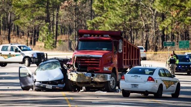 Authorities say a dump truck collided with a minivan on Fort Bragg Jan. 6, 2015, killing the mini-van's driver. (Courtesy of The Fayetteville Observer)