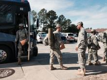 Troops that were deployed to West Africa to fight Ebola return to Fort Bragg on Jan. 22, 2015, after a 21-day medical quarantine at a base in Virginia.