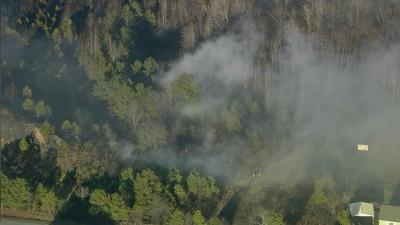 Firefighters were battling a large brush fire off of New Bethel Road in Johnston County on Thursday evening, officials said.