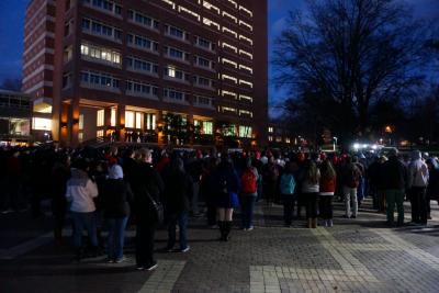 Hundreds attended a vigil at N.C. State University Thursday evening for three students slain in a Chapel Hill triple-homicide. Two of the students graduated from NCSU and the other was a current student. (Andrew Cumbee/WRAL)