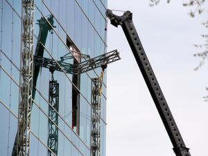 Crews remove the remains of collapsed scaffolding from the Charter Square building in downtown Raleigh on March 26, 2015. Three constructions workers were killed and a fourth was injured three days earlier when the scaffolding collapsed.