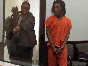 Kelton Breshon Fox, 17, is ushered into court for his first appearance Wednesday. Fox is charged with murder in the death of his ex-girlfriend, 17-year-old Tierra Hall.