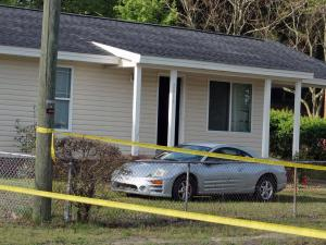 Authorities say one person died early Friday after shots were fired into the living room of a home in southwest Fayetteville.