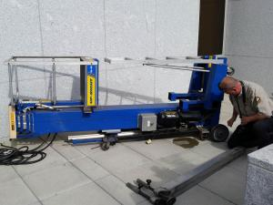 An inspector examines a hydraulic lift that toppled outside the State Archives on April 13, 2015, injuring a state worker. (Photo provided by N.C. Department of Administration)