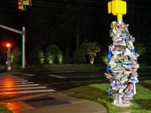 Residents of Holly Springs wrapped shoes around a utility pole at the intersection of Holly Springs Road and Linksland Drive following the death of Derek Davis, a 37-year-old who was hit at the intersection on April 20 while jogging with his wife. Davis died April 27.