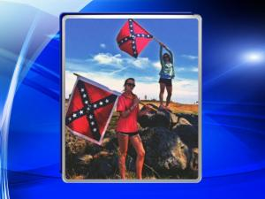 """The father of a student at East Chapel Hill High School said Wednesday that his daughter did not mean to offend anyone in late April when she posted a photo to social media of two Confederate flags with the caption """"South will rise."""""""