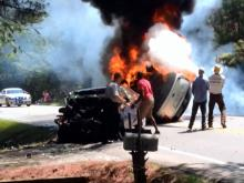 Raw: Video of rescue effort after fiery wreck