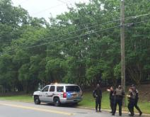 Cumberland County sheriff's deputies were searching along Cross Creek Wednesday afternoon for a man who fled, stripping off his clothes as he went, from the Cumberland County Courthouse.