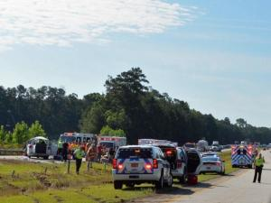 Multiple people were injured Saturday morning in a wreck involving a van on Interstate 40 West near Benson, Johnston County authorities said. (Photo by John Payne)