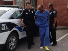 Authorities transport Garry Yarborough, who is charged with first-degree murder in the shooting death of his ex-girlfriend, Tracy Williams.