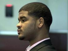 Carlos Riley Jr. listens to testimony on Aug. 5, 2015. He is accused of shooting a Durham police officer.