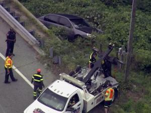 Sky 5 provides an overhead view as a tow truck pulls a car off an embankment at I-85 and U.S. 70 in Durham on Aug. 10, 2015.