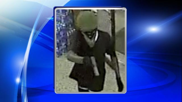According to police, the suspect walked into the shop, located at 1015 Hope Mills Road, holding a handgun.