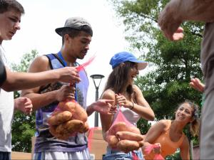 Duke University bags thousands of potatoes to feed the hungry