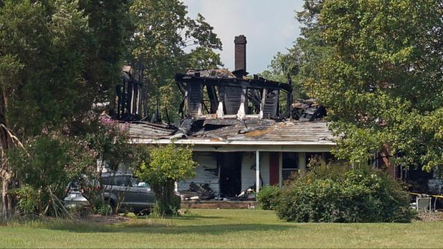 An 83-year-old woman died late Friday after fire broke out in her Orange County home.
