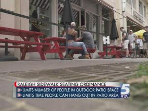 After a three week grace period, businesses now face a fine for not complying with the ordinance that limits the number of people being served in outdoor patio space .