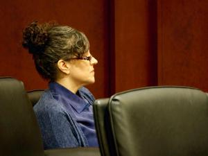 Joanna Madonna listens to testimony during her trial for the murder of her husband.