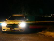 Police said that officers were dispatched to the area at 5:54 p.m. and discovered a deceased person in an undeveloped section of the 100 block of Ganyard Farm Way.