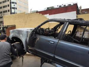 Emergency crews shut down a parking deck on South Wilmington Street in Raleigh on Nov. 3, 2015, after an SUV went up in flames.