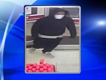 Fayetteville police released new surveillance images early Friday of two suspects who are wanted in a string of armed robberies.