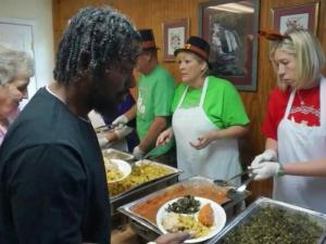 Volunteers served more than 1000 free dinners at Angie's Restaurant on Thanksgiving.