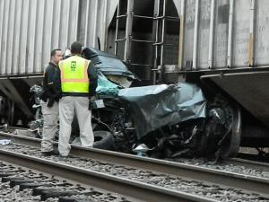 An SUV was struck by a freight train in Moore County Thursday morning, killing the driver on impact. (Photos courtesy Billy Marts / Aberdeen Times)