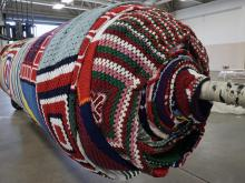 The world's largest Christmas stocking - a 1,600-pound, 7,700-square-foot behemoth that took more than a year to create - will be unveiled Saturday evening at Fayetteville's Arnette Park.