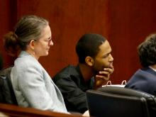 Travion Smith listens to testimony along with his defense lawyers Jonathan Broun and Pheobe Dee.