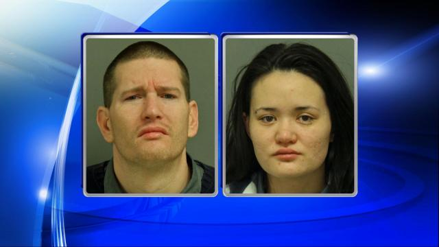 Aaron Russell Wagoner, 36, of 2628 Arbor View Drive in Cary was arrested inside the bank and his wife, Hannah Wagoner, 22, of the same address, was arrested Wednesday evening.