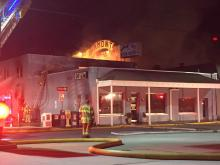 Flames burst through the roof of the Haymont Grill and Steak House, at 1304 Morganton Road, at about 3:30 a.m. (Photos by: Terry Dietrick)