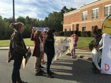 Protesters on Friday rallied outside the University of North Carolina's Board of Governors meeting in Chapel Hill that was moved from the school's Asheville campus due to concerns about potential protests.