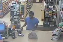 Authorities are trying to identify four suspects who followed a man home from a gas station on Monday and robbed him at gunpoint.