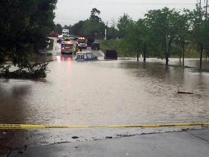 No patients were inside a private ambulance Thursday morning when it was trapped by high water in south Raleigh. (Photo by Leyla Santiago)